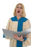 Female Choir Member 3. Blond woman in a choir robe holding a music folder and singing Royalty Free Stock Photo
