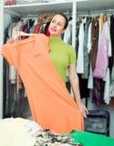 Female choosing apparel at store Royalty Free Stock Image