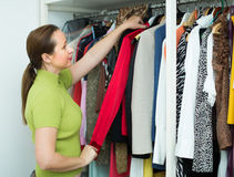 Female choosing apparel at store Royalty Free Stock Photo