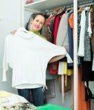 Female choosing apparel at store Stock Photos