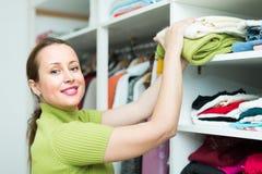Female choosing apparel at store Royalty Free Stock Photos