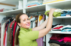 Female choosing apparel at store Stock Photography