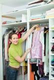 Female choosing apparel at store Stock Photo