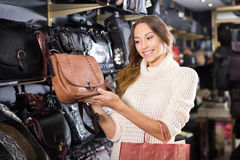 Female choosing bag among assortment Stock Photos
