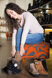 Female choosing winter women shoes Royalty Free Stock Photography