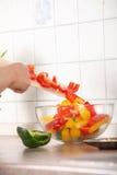 Female chopping food Stock Photo