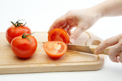 Female chopping tomatoes Royalty Free Stock Images