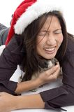 Female with christmas hat and playing with pug Royalty Free Stock Photo