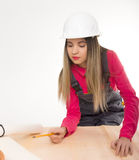 Female civil engineer standing next to the table Stock Photography