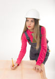 Female civil engineer standing next to the table Royalty Free Stock Photo