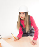 Female civil engineer standing next to the table Stock Photos