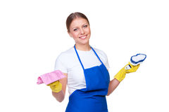 Female cleaner in blue apron Stock Photography