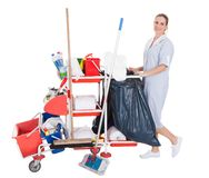 Female Cleaner With Cleaning Equipment Royalty Free Stock Photography