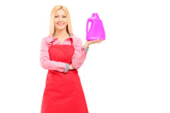 Female cleaner holding a bottle of detergent and posing Stock Photography