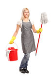 Female cleaner holding a bucket Royalty Free Stock Photography