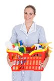 Female Cleaner Holding Chemical Supplies In Basket Royalty Free Stock Images