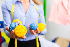 Female cleaner in laundry shop Stock Image