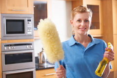 Female Cleaner Working In Kitchen Stock Images