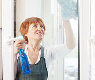 Female cleaning window Stock Photo