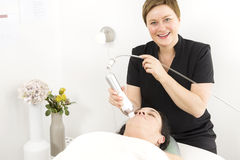 Female client get face treatments at beauty clinic Royalty Free Stock Image