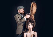 Female client getting haircut by hairdresser. Woman visiting hairstylist in hair salon. Beauty Model girl with Healthy. Hair royalty free stock image