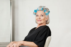 Female Client With Hair Curlers At Salon Stock Image