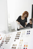 Female Client And Hairdresser Looking At Color Chart Royalty Free Stock Images