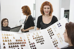 Female Client And Hairdresser Looking At Color Chart Stock Photo