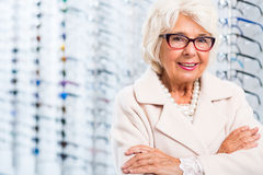 Female client of optical shop. Picture of elderly female client of optical shop Stock Photography