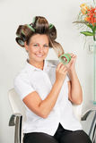 Female Client Removing Curlers Stock Photos