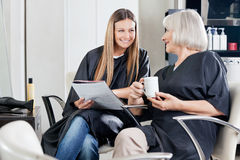 Female Client's Conversing At Beauty Parlor Stock Images
