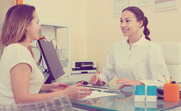 Female client visiting in aesthetic medicine center Royalty Free Stock Photo