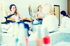 Female clients doing toenails Stock Images
