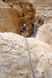 Climber rappelling from dry waterfall. Stock Image