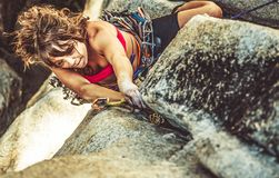 Female climber determined to succeed. Royalty Free Stock Photo