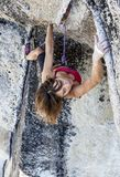 Female climber determined to succeed. Royalty Free Stock Photography