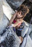 Female climber determined to succeed. Stock Image