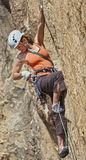 Female climber challenged. Royalty Free Stock Image