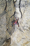 Female climber clinging to the edge. Royalty Free Stock Photos