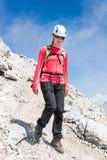 Female climber descending a mountain trail. Female climber descending a steep mountain trail Royalty Free Stock Photo