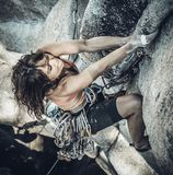 Female climber determined to succeed. Stock Photos