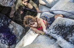 Female climber determined to succeed. Royalty Free Stock Images