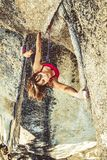 Female climber determined to succeed. Royalty Free Stock Photos
