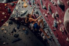 Female climber. Extreme indoor climbing. Stock Image
