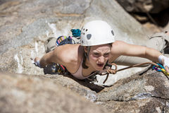 Female climber going for the summit. Stock Photo