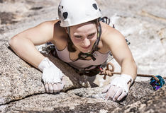 Female climber going for the summit. Stock Photography