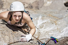 Female climber going for the summit. Royalty Free Stock Photos