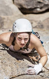Female climber going for the summit. Stock Images