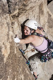 Female climber going for the summit. Royalty Free Stock Image