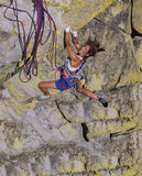 Female climber going for the summit. Royalty Free Stock Images